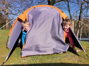 James (left) and Owen who have been sleeping out in their tent to raise money for charity.