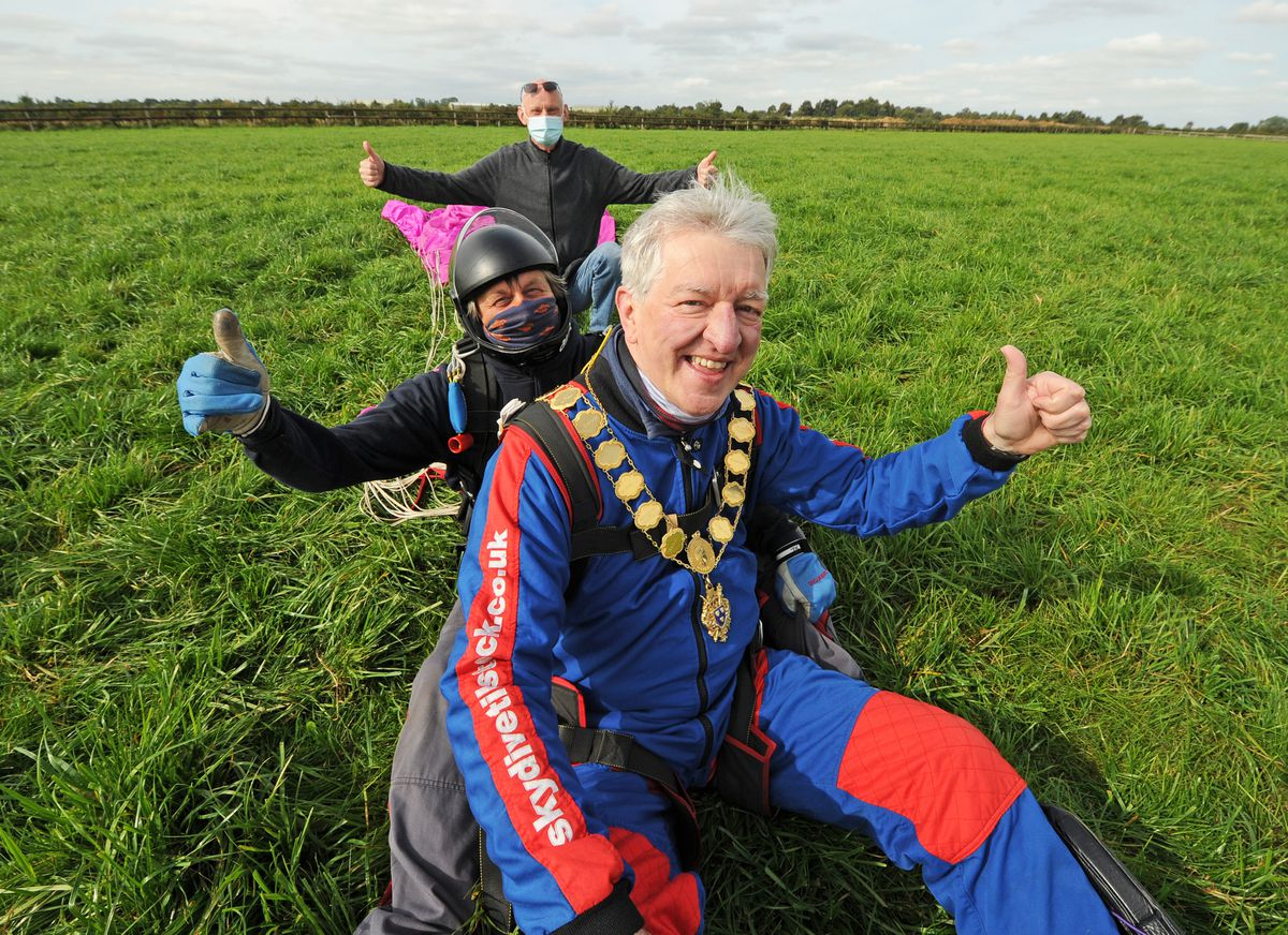 Safely back on land, following his skydive for the Samaritans, the mayor of Shrewsbury Phil Gillam, at Tilstock Airfield, Whitchurch, with tandem instructor Darrell Gibson, being supported by Samaritans volunteer Ricahrd Dunnill
