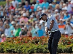 Quadruple bogey at 17th threatens to derail Woods' Players Championship charge