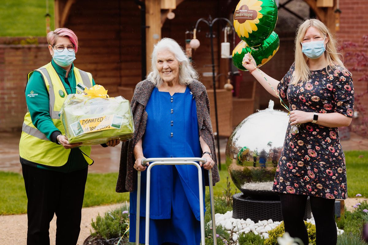 Carla Taylor from Morrisons, Radbrook Nursing Home resident Joyce Rogers, and Justine Ellory, community relationship manager at the home