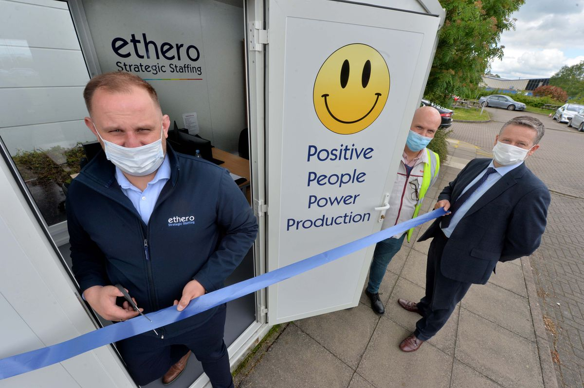 Cutting the ribbon is Peter Olszak, and in the yellow bib from Makita is Richard Annett with Ethero MD Gareth Hughes