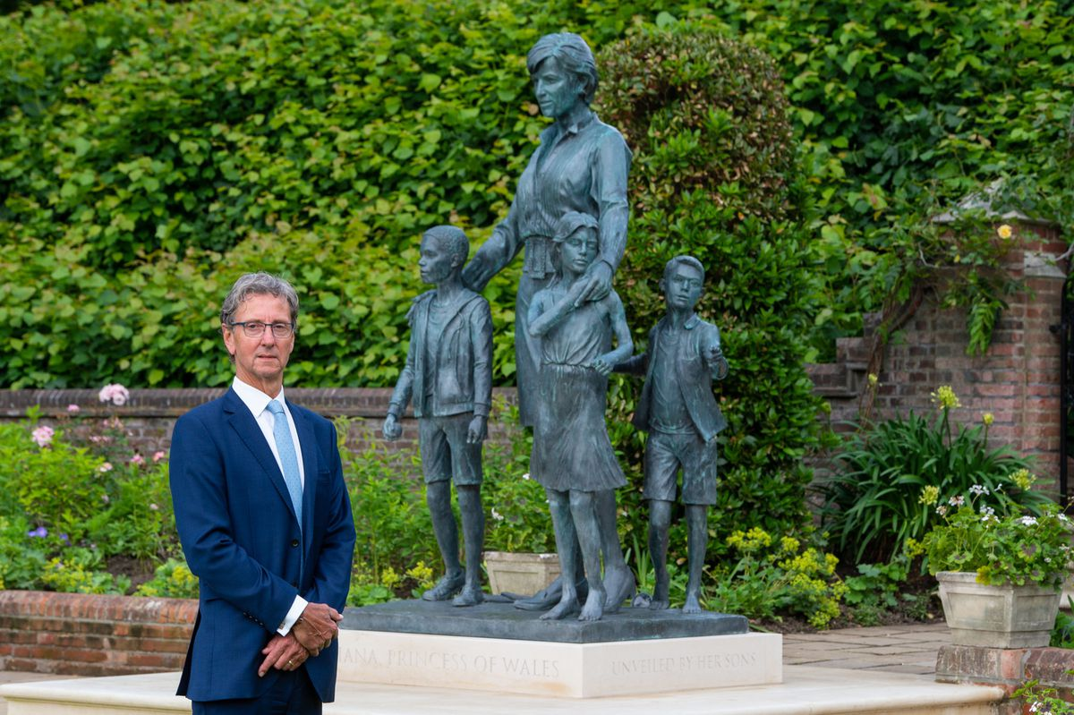 Sculptor Ian Rank-Broadley with his statue of Diana, Princess of Wales, in the Sunken Garden at Kensington Palace, London.