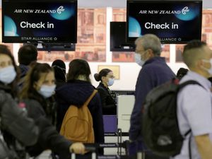 Passengers prepare at Sydney Airport to catch a flight to New Zealand as the much-anticipated travel bubble between Australia and New Zealand opens