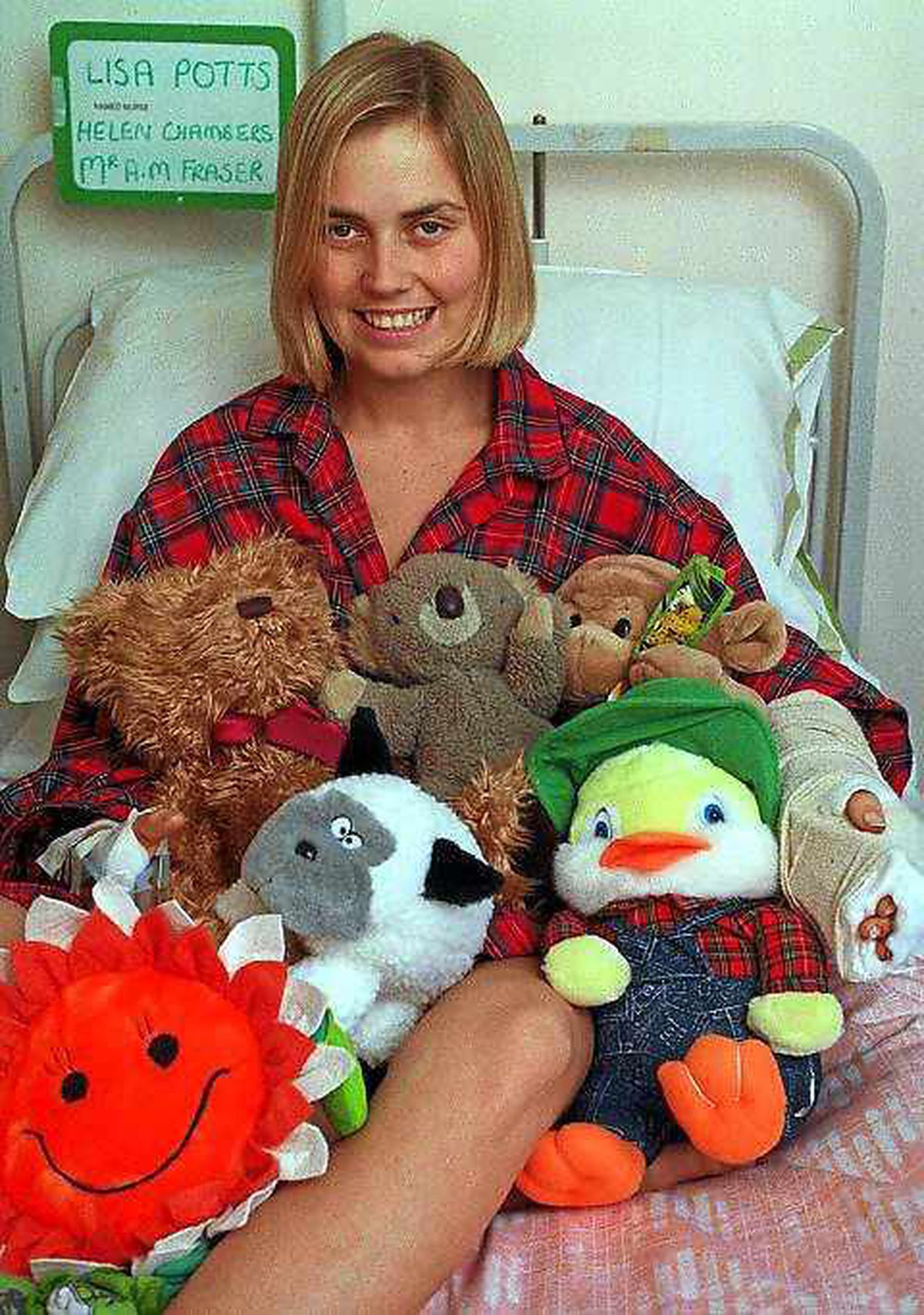 All smiles – Lisa Potts recovering in hospital following the horrific attack